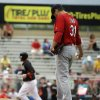 Photo - St. Louis Cardinals starting pitcher Lance Lynn, right, stands on the mound after giving up a home run to Miami Marlins' Casey McGehee, left, in the fourth inning of an exhibition spring training baseball game, Tuesday, March 25, 2014, in Jupiter, Fla. (AP Photo/David Goldman)