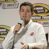 Photo - Kyle Larson, driver for Chip Ganassi Racing with Felix Sabates, speaks to the media during a news conference at the NASCAR Sprint Cup auto racing Media Tour in Charlotte, N.C., Tuesday, Jan. 28, 2014. (AP Photo/Chuck Burton)