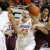 Photo - Oklahoma State's Lindsey Keller (25) and Texas State's Taylor McGilbra (14) fight for the ball during a women's college basketball game between Oklahoma State University and Texas State at Gallagher-Iba Arena in Stillwater, Okla., Wednesday, Nov. 28, 2012.  Photo by Bryan Terry, The Oklahoman