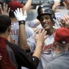 Photo -   Houston Astros' Justin Maxwell, right, celebrates with teammates in the dugout after hitting a two-run home run against the Chicago White Sox in the fifth inning during a baseball game in Chicago, Sunday, June 10, 2012. (AP Photo/Paul Beaty)