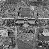 AERIAL VIEWS--Ringed by a maze of roadways and parking lots is the Oklahoma State Capitol Building, sitting at the base of a horseshoe-shaped array of office buildings. Cars and school buses compete for parking space around the state\'s seat of power during the legislative session. Staff Photo by Al McLaughlin taken 3/29/77.