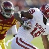 Oklahoma wide receiver Justin Brown, right, runs from Iowa State linebacker C.J. Morgan, left, after making a reception during the first half of an NCAA college football game, Saturday, Nov. 3, 2012, in Ames, Iowa. Oklahoma won 35-20. (AP Photo/Charlie Neibergall) ORG XMIT: IACN121