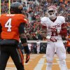 Oklahoma\'s Lacoltan Bester (11) celebrates in front of Oklahoma State\'s Justin Gilbert (4) after OU scored a touchdown in the final minute of the Bedlam college football game between the Oklahoma State University Cowboys (OSU) and the University of Oklahoma Sooners (OU) at Boone Pickens Stadium in Stillwater, Okla., Saturday, Dec. 7, 2013. Oklahoma won 33-24. Photo by Bryan Terry, The Oklahoman