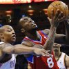 Philadelphia 76ers guard Tony Wroten (8) is fouled by Oklahoma City Thunder forward Caron Butler during the first quarter of an NBA basketball game in Oklahoma City, Tuesday, March 4, 2014. (AP Photo/Sue Ogrocki)