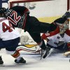Photo - After taking a shot on goal, Carolina Hurricanes' Eric Staal (12) dives past Florida Panthers' goalie Dan Ellis (39) and Erik Gudbranson (44) during the second period of an NHL hockey game in Sunrise, Fla., Thursday, March 27, 2014. (AP Photo/J Pat Carter)