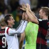 Germany\'s Per Mertesacker, right, and Miroslav Klose celebrate after the World Cup semifinal soccer match between Brazil and Germany at the Mineirao Stadium in Belo Horizonte, Brazil, Tuesday, July 8, 2014. Germany won the match 7-1. (AP Photo/Martin Meissner)