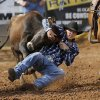 Quinton Inman of Ketchum, OK, works to bring this steer to a halt in the steer wrestling event during the morning go-round at the IFYR rodeo on Thursday, July 11, 2013. July 10, 2013. Photo by Jim Beckel, The Oklahoman.
