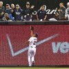 Photo - San Diego Padres right fielder Will Venable makes a running catch on a deep drive by Los Angeles Dodgers' A.J. Ellis in the fifth inning of a baseball game Wednesday, April 2, 2014, in San Diego.  (AP Photo/Lenny Ignelzi)