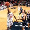 Photo - Virginia guard Faith Randolph (20) shoots next to Notre Dame forward Natalie Achonwa during the first half of an NCAA college basketball game on Sunday, Jan. 12, 2014, in Charlottesville, Va. Notre Dame defeated Virginia  79-72. (AP Photo/Andrew Shurtleff)