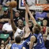Utah Jazz forward Derrick Favors (15) lays the ball up as Minnesota Timberwolves forwards Kevin Love (42) and Andrei Kirilenko (47) defend and center Nikola Pekovic (14) watches in the first quarter of an NBA basketball game, Wednesday, Jan. 2, 2013, in Salt Lake City. (AP Photo/Rick Bowmer)