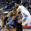 Oklahoma City Thunder guard Russell Westbrook (0) loses the ball as he runs into Denver Nuggets forward Wilson Chandler (21) during the first half in game 4 of a first-round NBA basketball playoff series Monday, April 25, 2011, in Denver. (AP Photo/Jack Dempsey)