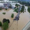 Photo - This image made available by the Serbian police shows the flooded area in Obrenovac, some 30 kilometers (18 miles) southwest of Belgrade, Serbia, Sunday, May 18, 2014. In Serbia, more than 20,000 people have been forced from their homes. Officials there fear more flooding later Sunday as floodwaters travel down the Sava and reach the country. Serbian officials said that the flood wave might be lower than initially expected, because the river broke barriers upstream in Croatia and Bosnia. Experts said they expect Sava floodwaters to rise for two more days, then subside. (AP Photo/Serbian Police)