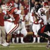 OU\'s Travis Lewis (28) breaks away from Baron Batch (25) of Texas Tech after Lewis intercepted a Graham Harrell pass late in the second quarter of the college football game between the University of Oklahoma Sooners and Texas Tech University at Gaylord Family -- Oklahoma Memorial Stadium in Norman, Okla., Saturday, Nov. 22, 2008. BY NATE BILLINGS, THE OKLAHOMAN