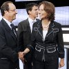 Photo - FILE - In this Sept. 15, 2011 file photo, candidates for the 2011 French Socialist party primary elections Francois Hollande, left, shakes hands with Segolene Royal, right, while Manuel Valls, center back, looks on before a televised debate in Paris. Royal, French President Francois Hollande's former partner, has been named Wednesday April, 2, 2014 as Minister of Environment and Energy. Valls is now Prime Minister. (AP Photo/Patrick Kovarik, Pool-File)