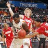 UNM\'s Kendall Williams (10) tries to take the ball from OSU\'s Jean-Paul Olukemi (0) in front of UNM\'s Hugh Greenwood (3) and Chad Adams (4) in the first half during the Bill Russell men\'s college basketball game of the Ramada All-College Classic between the Oklahoma State University Cowboys and the University of New Mexico Lobos at the Chesapeake Energy Arena in Oklahoma City, Saturday, Dec. 17, 2011. Photo by Nate Billings, The Oklahoman
