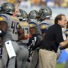 Photo - West Virginia coach Dana Holgorsen, right, encourages his players during their NCAA college football game against Maryland in Morgantown, W.Va., Saturday, Sept. 22, 2012. WVU won 31-21 (AP Photo/Christopher Jackson) ORG XMIT: WVCJ124