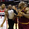 Photo - Washington Wizards guard Bradley Beal (3) and Cleveland Cavaliers guard Jarrett Jack (1) are separated by a referee after an NBA basketball game on Saturday, Nov. 16, 2013, in Washington. The Cavaliers won 103-96 in overtime. (AP Photo/Alex Brandon)