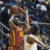 Iowa State\'s DeAndre Kane, left, looks to shoot over West Virginia\'s Terry Henderson during the first half of an NCAA college basketball game, Monday, Feb. 10, 2014, in Morgantown, W.Va. (AP Photo/Andrew Ferguson)