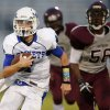 Mount St. Mary\'s Matt Peace runs past Northeast\'s D\'Angelo Todd during their high school football game at Douglass in Oklahoma City, Thursday, Sept. 19, 2013. Photo by Bryan Terry, The Oklahoman