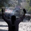 Egyptian security forces, background, clash with protesters near Tahrir Square in Cairo, Egypt, Sunday, Nov. 25, 2012. Supporters and opponents of Egypt\'s president grow more entrenched in their potentially destabilizing battle over the Islamist leader\'s move to give himself near absolute powers, with neither side appearing willing to back down. (AP Photo/Ahmed Gomaa)