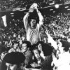 Photo - FILE - In this July 11, 1982 file photo, Italian team captain and goalkeeper Dino Zoff, is raised aloft by his teammates while holding the World Cup in the Santiago Bernabeu Stadium, in Madrid, after Italy defeated West Germany 3-1 in the World Cup final soccer match. On this day: After a 44 year interval Italy finally wins its third World Cup.  (AP Photo/File)
