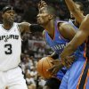 Oklahoma City\'s Serge Ibaka (9) looks to the basket beside San Antonio\'s Stephen Jackson (3) during Game 5 of the Western Conference Finals between the Oklahoma City Thunder and the San Antonio Spurs in the NBA basketball playoffs at the AT&T Center in San Antonio, Monday, June 4, 2012. Photo by Nate Billings, The Oklahoman