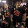 Oklahoma State\'s Quinn Sharp (13) celebrates with Connor Sinko (56) after winning the Fiesta Bowl between the Oklahoma State University Cowboys (OSU) and the Stanford Cardinal at the University of Phoenix Stadium in Glendale, Ariz., Tuesday, Jan. 3, 2012. Photo by Bryan Terry, The Oklahoman