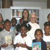 Members of the Oklahoma City Pi Beta Phi Alumnae Club and participants in the after school program Back to Basics take a look at the program's new library, which the alumnae club donated through its annual Gathering of Angels fundraising event. Front row: Jasmine Richy, Rayven Lane, Camron Alexander and Reality Booker. Back row: Diane Kenney, Carl Brown, Vikki Kembel, Susie Blinn and Wandalene Black. Community Photo By: Mary Ann Osko Submitted By: Mary Ann, oklahoma city