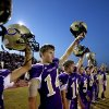 Chickasha raises their helmets during the opening kick-off during the football game between Chickasha and Capitol Hill at Chickasha High School, Friday, Oct. 1, 2010. It was the first home game since the death of player Kody Turner. Photo by Sarah Phipps, The Oklahoman