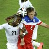 Ghana\'s John Boye, left, and United States\' Aron Johannsson go for a header during the group G World Cup soccer match between Ghana and the United States at the Arena das Dunas in Natal, Brazil, Monday, June 16, 2014. (AP Photo/Hassan Ammar)