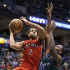Toronto Raptors\' Landry Fields (2) drives against Milwaukee Bucks\' Luc Richard Mbah a Moute, right, during the first half of an NBA basketball game Saturday, March 2, 2013, in Milwaukee. (AP Photo/Jeffrey Phelps)