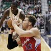 Photo - Los Angeles Clippers power forward Blake Griffin (32) shoots from the floor as Utah Jazz power forward Paul Millsap rushes to him in the first quarter of an NBA basketball game, Monday, Dec. 3, 2012, in Salt Lake City. (AP Photo/Rick Bowmer)