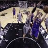 Photo - Phoenix Suns' Goran Dragic, 1, of Slovenia, shoots as San Antonio Spurs' Tiago Splitter (22), of Brazil, defends during the first quarter of an NBA basketball game, Saturday, Jan. 26, 2013, in San Antonio, Texas. (AP Photo/Eric Gay)