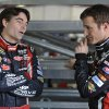 Drivers Jeff Gordon, left, and Kasey Kahne confer in the garage area of the Talladega Superspeedway in Talladega, Ala., Friday, Oct. 5, 2012. The drivers were preparing for the Sunday running of the NASCAR Sprint Cup Series auto race. (AP Photo/Rainier Ehrhardt)