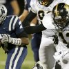 Edmond North\'s Marque Depp runs past Midwest City\'s Tyquae Russell during their high school football game at Wantland Stadium in Edmond, Thursday, October 25, 2012. Photo by Bryan Terry, The Oklahoman