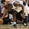 Chicago Bulls guard Kirk Hinrich (12) and Dallas Mavericks guard Mike James (13) dive for the loose ball off of James during the first half of an NBA basketball game, Saturday, March 30, 2013, in Dallas. (AP Photo/ Michael Mulvey)