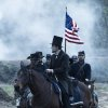This undated publicity photo provided by DreamWorks and Twentieth Century Fox shows Daniel Day-Lewis as President Abraham Lincoln looking across a battlefield in the aftermath of a terrible siege in this scene from director Steven Spielberg\'s drama