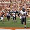 Oklahoma State\'s Jeremy Smith (31) scores a touchdown during first half of a college football game between the Oklahoma State University Cowboys (OSU) and the University of Texas Longhorns (UT) at Darrell K Royal-Texas Memorial Stadium in Austin, Texas, Saturday, Oct. 15, 2011. Photo by Sarah Phipps, The Oklahoman