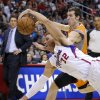 Los Angeles Clippers\' Blake Griffin, front, gets to a loose ball next to Phoenix Suns\' Goran Dragic during the first half of an NBA basketball game in Los Angeles, Saturday, Dec. 8, 2012. (AP Photo/Jae C. Hong)
