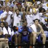 Memphis Grizzlies fans cheer behind the Oklahoma City Thunder bench during the second half of Game 6 of a second-round NBA basketball playoff series on Friday, May 13, 2011, in Memphis, Tenn. The Grizzlies won 95-83 to even the series 3-3. (AP Photo/Lance Murphey)