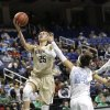 Photo - Wake Forest's Dearica Hamby (25) drives past North Carolina's Jessica Washington (24) during the first half of an NCAA college basketball game at the Atlantic Coast Conference tournament in Greensboro, N.C., Thursday, March 6, 2014. (AP Photo/Chuck Burton)