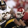 Oklahoma\'s Gabe Lynn stops Missouri\'s Henry Josey for a loss during their game on Saturday in Norman. Photo by Steve Sisney, The Oklahoman
