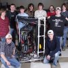 MNTC Pre-Engineering students representing Norman North, Norman, Moore and Westmoore High Schools stand next to the robot they\'ve designed and will compete with in the FIRST Robotics Regional Competition in Texas. Community Photo By: Jason Graham, MNTC Submitted By: Anna,