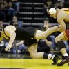 Iowa\'s Ethan Lofthouse, left, tries to escape form Iowa State\'s Boez Beard during their 184 lbs. match in an NCAA college wrestling meet on Saturday, Dec. 1, 2012, in Iowa City, Iowa. (AP Photo/Charlie Neibergall)