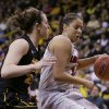Photo - Louisville guard Shoni Schimmel, right, drives past Iowa guard Samantha Logic during the second half of an NCAA tournament second-round women's college basketball game, Tuesday, March 25, 2014, in Iowa City, Iowa. (AP Photo/Charlie Neibergall)
