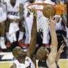 Photo - San Antonio Spurs power forward Matt Bonner (15) shoots against Miami Heat center Joel Anthony (50) during the first half of Game 1 of basketball's NBA Finals, Thursday, June 6, 2013 in Miami. (AP Photo/Wilfredo Lee)