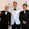 Brazilians Claudio Torres, left, and Mauro Wilson, right, flank presenter Cheyenne Jackson after winning the Comedy award for