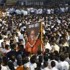 FILE - In this Nov. 18, 2012 file photo, Indian mourners carry a poster of Hindu hardline Shiv Sena party leader Bal Thackeray with the words