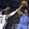 Oklahoma City\'s Russell Westbrook (0) shoots as Memphis\' Mike Conley (11) defends during Game 6 in the first round of the NBA playoffs between the Oklahoma City Thunder and the Memphis Grizzlies at FedExForum in Memphis, Tenn., Thursday, May 1, 2014. Photo by Bryan Terry, The Oklahoman
