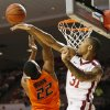 Oklahoma\'s D.J. Bennett (31) blocks the shot of Oklahoma State\'s Markel Brown (22) in the first half during the NCAA men\'s Bedlam basketball game between the Oklahoma State Cowboys (OSU) and the Oklahoma Sooners (OU) at Lloyd Noble Center in Norman, Okla., Monday, Jan. 27, 2014. Photo by Nate Billings, The Oklahoman